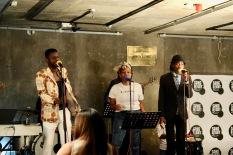 Dollar performing at Song Night.